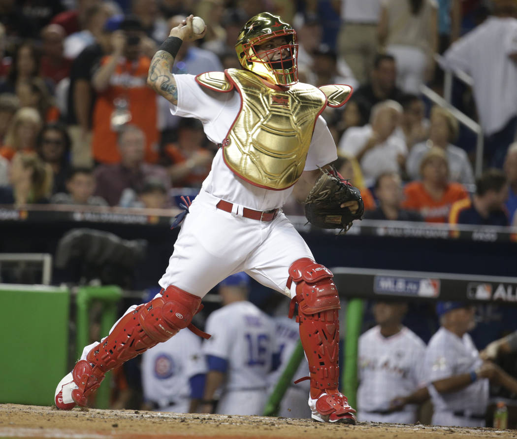 National League's St. Louis Cardinals catcher Yadier Molina (4), throws during the sixth inning at the MLB baseball All-Star Game, Tuesday, July 11, 2017, in Miami. (AP Photo/Lynne Sladky)