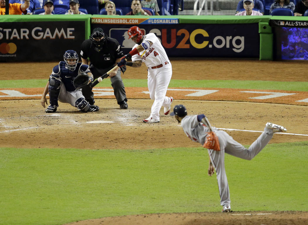 National League's St. Louis Cardinals' Yadier Molina (4) hits a home run against American League Minnesota Twins pitcher Ervin Santana (54) in the sixth inning during the MLB baseball All-Star Gam ...
