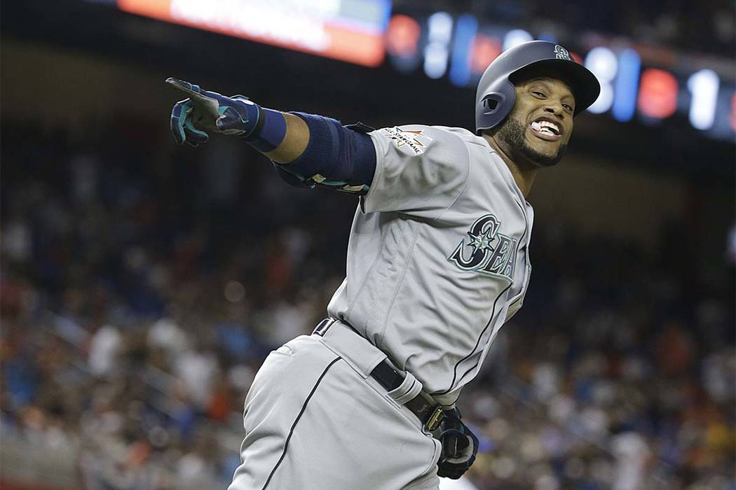 American League's Seattle Mariners Robinson Cano rounds the bases after hitting a home run in the 10th inning during Tuesday's All-Star Game,  July 11, 2017, in Miami. (Lynne Sladky/AP)