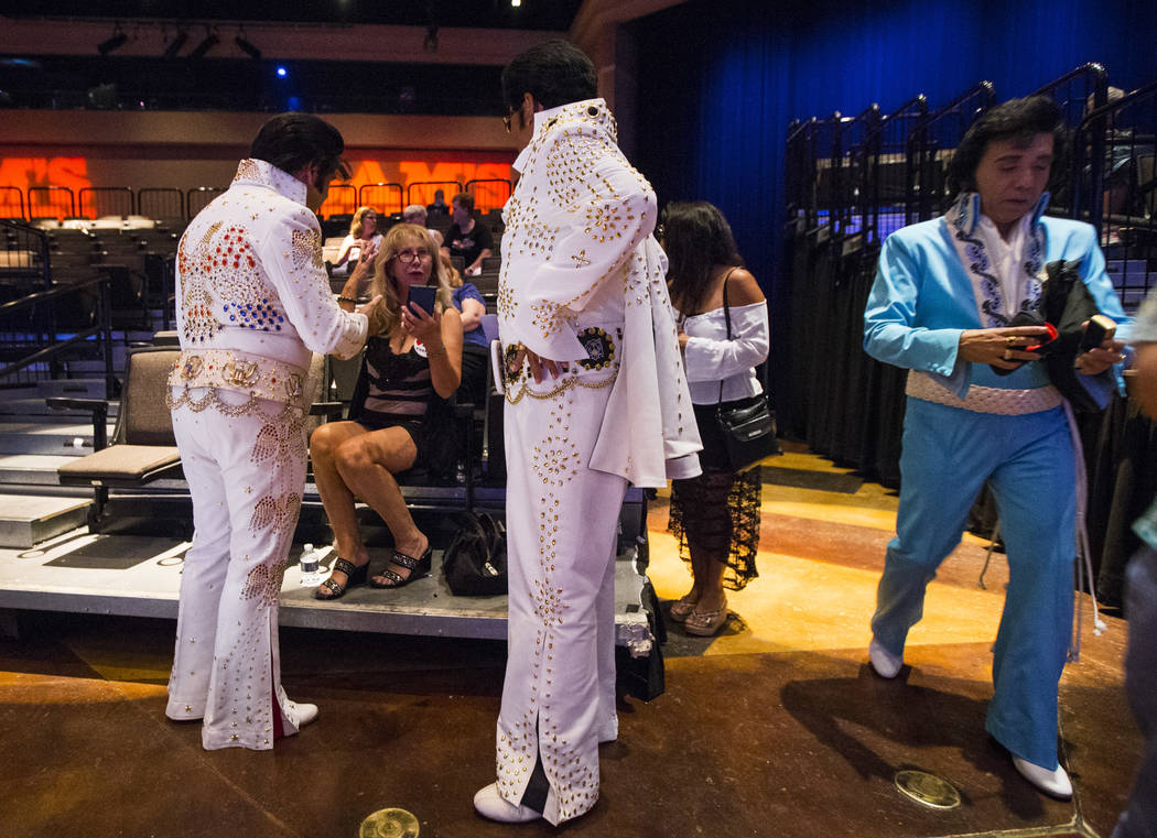 Margaret Castro, second from left, talks with Elvis impersonators James King, left, and her husband Bob Castro during the tribute artist contest at the Images of the King festival at Sam's Town in ...