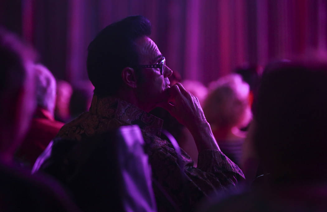 Paul Hildebrand watches elvis impersonators compete during the tribute artist contest at the Images of the King festival at Sam's Town in Las Vegas on Saturday, July 15, 2017. Chase Stevens Las Ve ...
