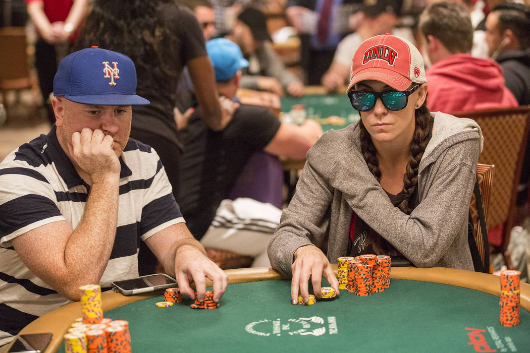 Las Vegas local poker professional Danielle Andersen, right, also known as Dmoongirl, plays in the World Series of Poker Main Event at the Rio Convention Center on Friday, July 14, 2017, in Las Ve ...