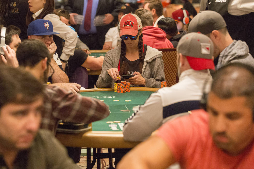 Las Vegas local poker professional Danielle Andersen, center, also known as Dmoongirl, plays in the World Series of Poker Main Event at the Rio Convention Center on Friday, July 14, 2017, in Las V ...