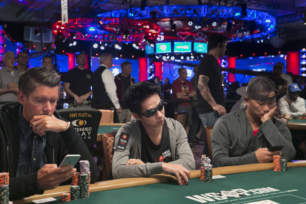 Randy Lew (center) plays poker during day five of The World Series of Poker at The Rio All-Suite Hotel and Casino in Las Vegas, Saturday, July 15, 2017. Gabriella Angotti-Jones Las Vegas Review-Jo ...