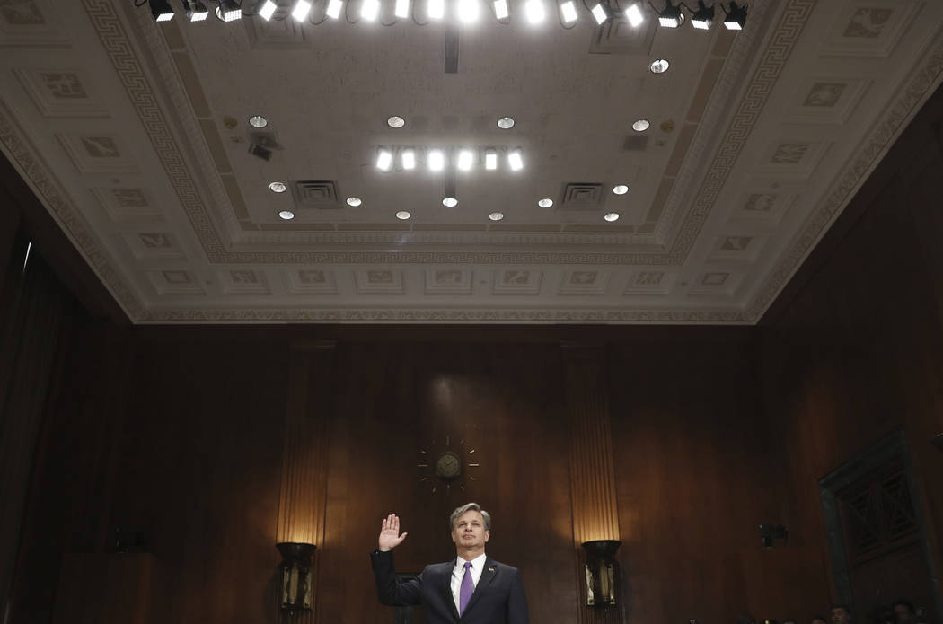 FBI director nominee Christopher Wray is sworn in on Capitol Hill in Washington, Wednesday, July 12, 2017, prior to testifying at his confirmation hearing before the Senate Judiciary Committee. (P ...