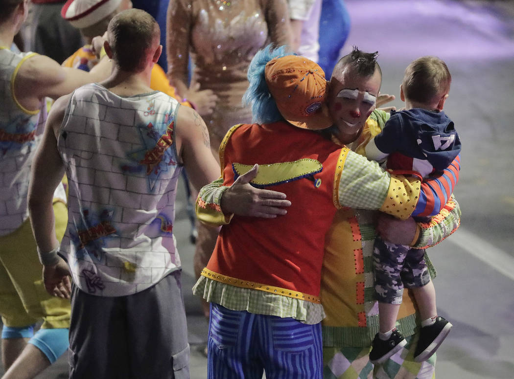 """Boss clown Sandor Eke hugs fellow clowns as he holds his 2-year-old son, Michael after the red unit's final performance, Sunday, May 7, 2017, in Providence, R.I. """"The Greatest Show on Ear ..."""