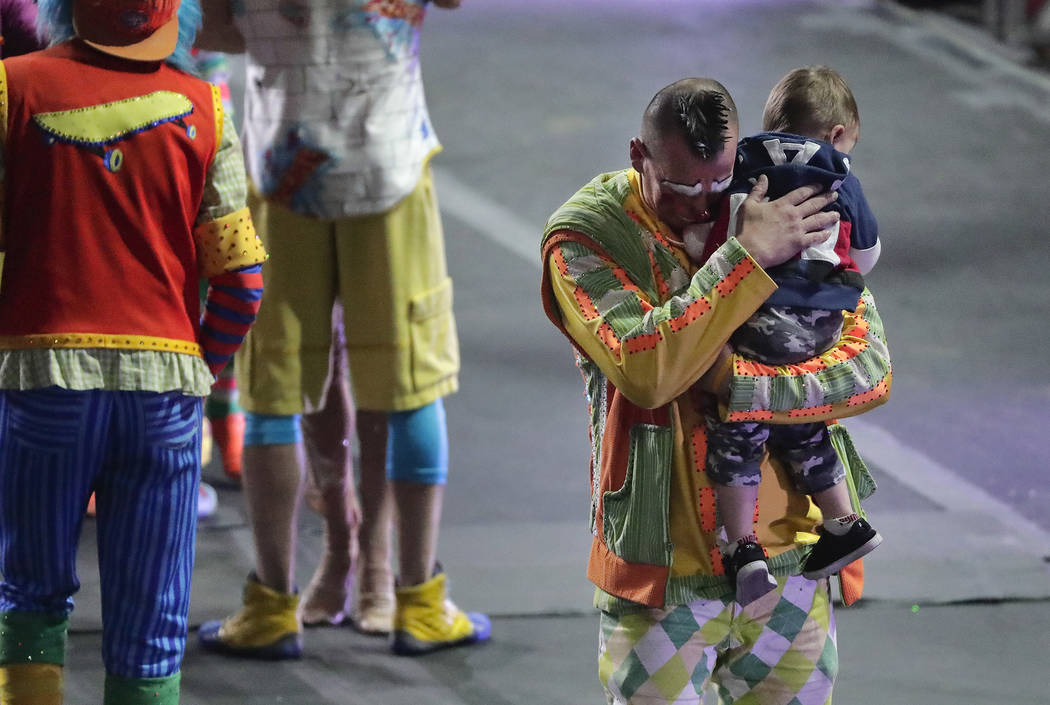 """Ringling Bros. boss clown Sandor Eke hugs his 2-year-old son Michael after the red unit's final show, Sunday, May 7, 2017, in Providence, R.I. """"The Greatest Show on Earth"""" is abo ..."""