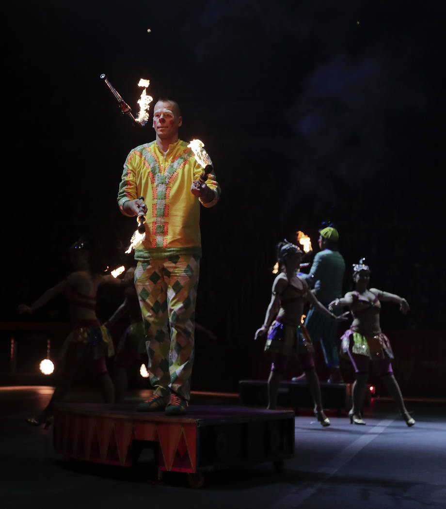 """Boss clown Sandor Eke juggles with fire during a show, Thursday, May 4, 2017, in Providence, R.I. """"The Greatest Show on Earth"""" is about to put on its last show on earth. For the  ..."""