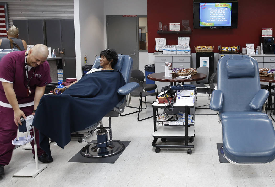 Eddie Herrera, left, phlebotomist, checks on Joy Holladay as she donates blood at United Blood Services on Tuesday, July 11, 2017, in Las Vegas. Bizuayehu Tesfaye Las Vegas Review-Journal @bizutesfaye