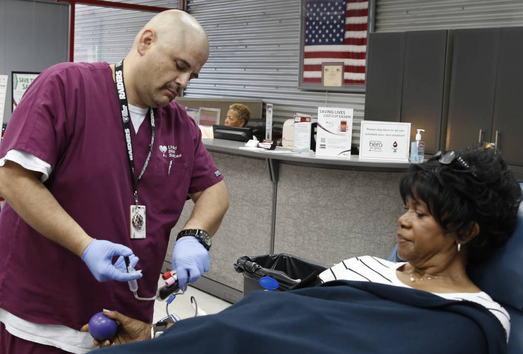 Eddie Herrera, left, Phlebotomist, draws blood from Joy Holladay at United Blood Services on Tuesday, July 11, 2017, in Las Vegas. Bizuayehu Tesfaye Las Vegas Review-Journal @bizutesfaye