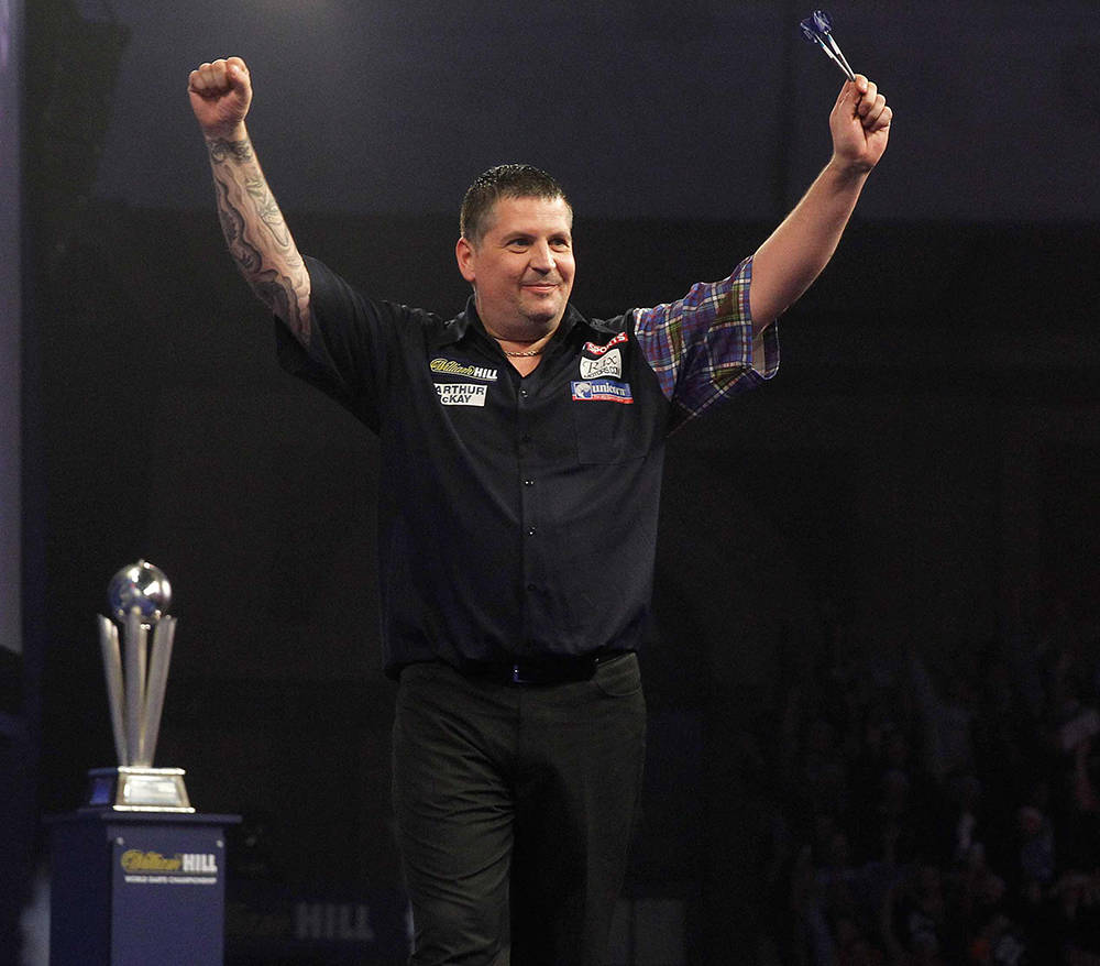 Gary Anderson wins his game against Adrian Lewis at the William Hill World Darts Championship 2016 in London.(Lawrence Lustig)