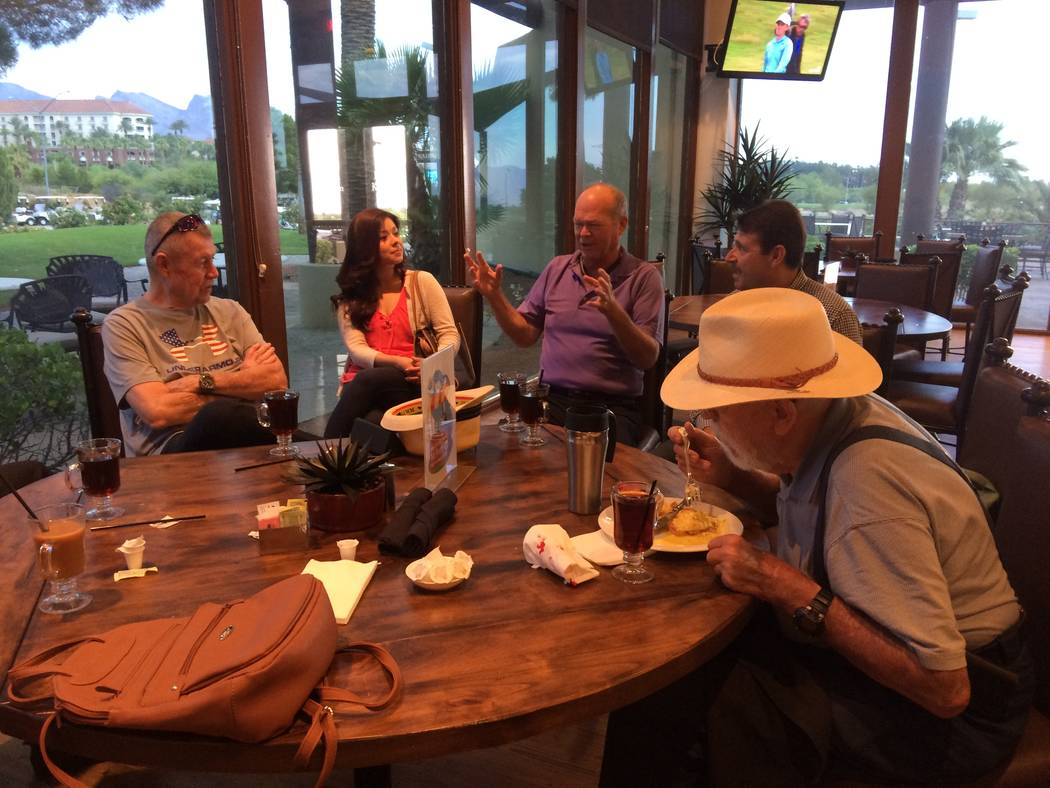Bob Beers, in purple, gestures as he talks with friends and well wishers June 7, 2017 at Angel Park Golf Course, about a week before leaving office as city councilman for Ward 2. His father, Frank ...