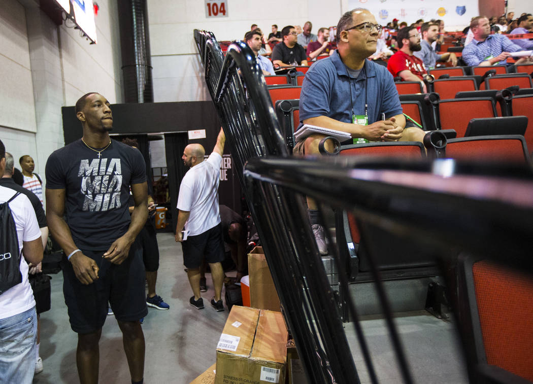 Miami Heat's Bam Adebayo, left, watches the Utah Jazz play the Phoenix Suns in a basketball game at the NBA Summer League at the Cox Pavilion in Las Vegas on Wednesday, July 12, 2017. Chase Steven ...