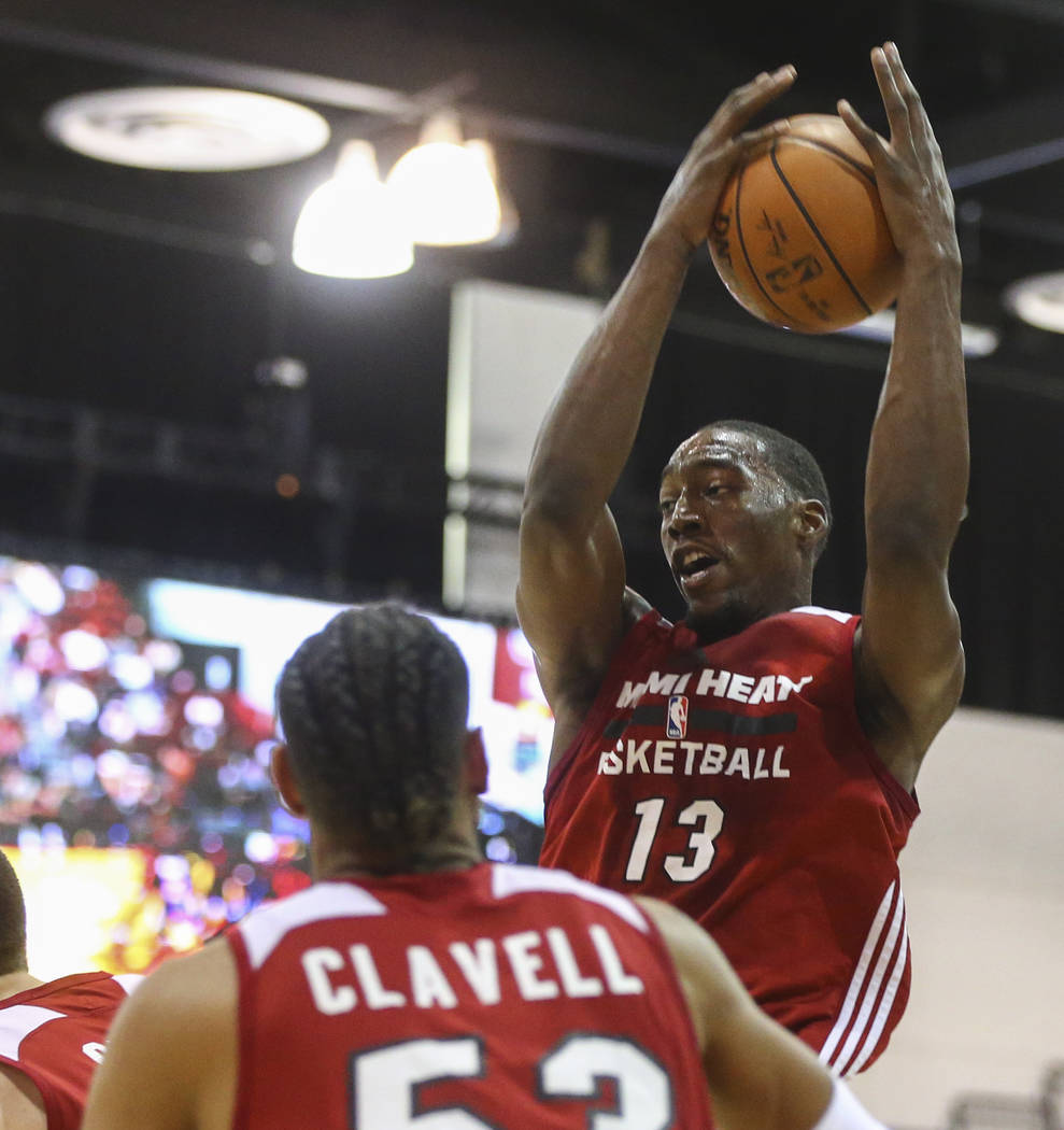 Miami Heat's Bam Adebayo (13) grabs a rebound during a basketball game against the Dallas Mavericks at the NBA Summer League at the Cox Pavilion in Las Vegas on Tuesday, July 11, 2017. Chase Steve ...