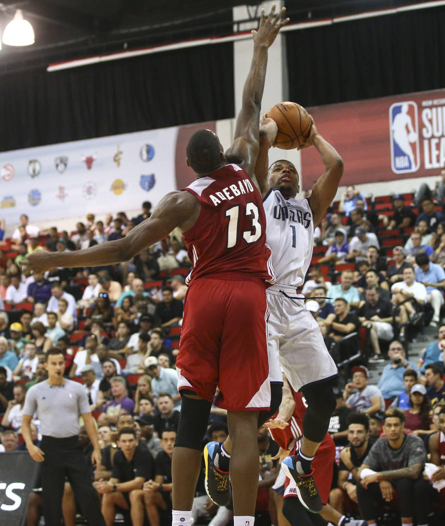 Miami Heat's Bam Adebayo (13) reaches out to block a shot from Dallas Mavericks' Dennis Smith Jr. (1) during a basketball game at the NBA Summer League at the Cox Pavilion in Las Vegas on Tuesday, ...