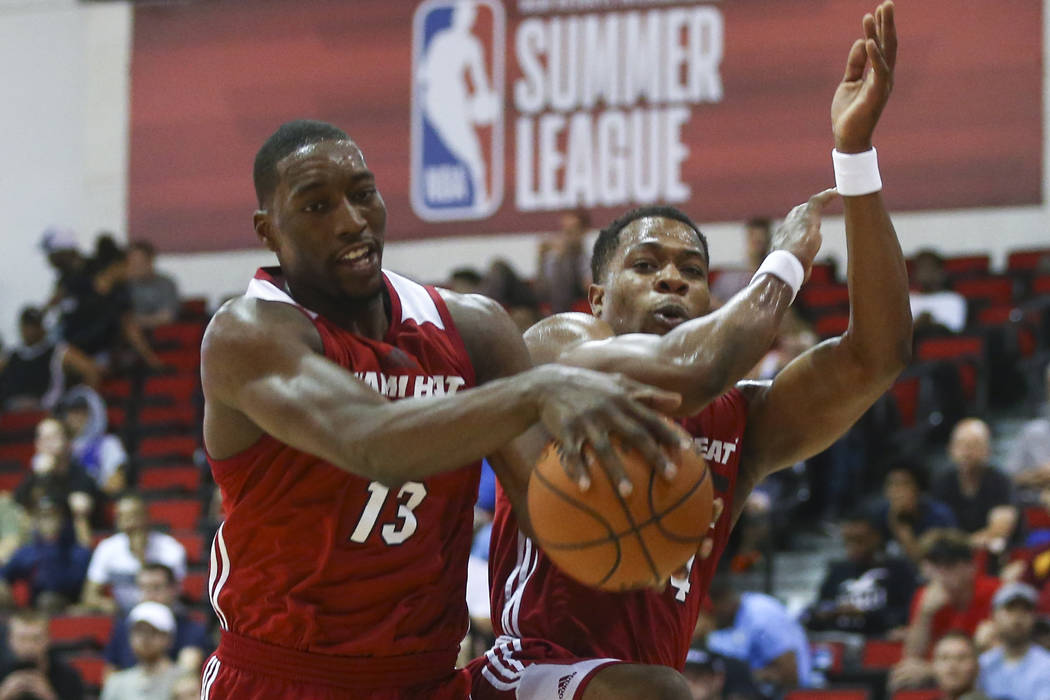 Miami Heat's Bam Adebayo (13) grabs a rebound next to Miami Heat's Matt Williams (54) during a basketball game against the Dallas Mavericks at the NBA Summer League at the Cox Pavilion in Las Vega ...