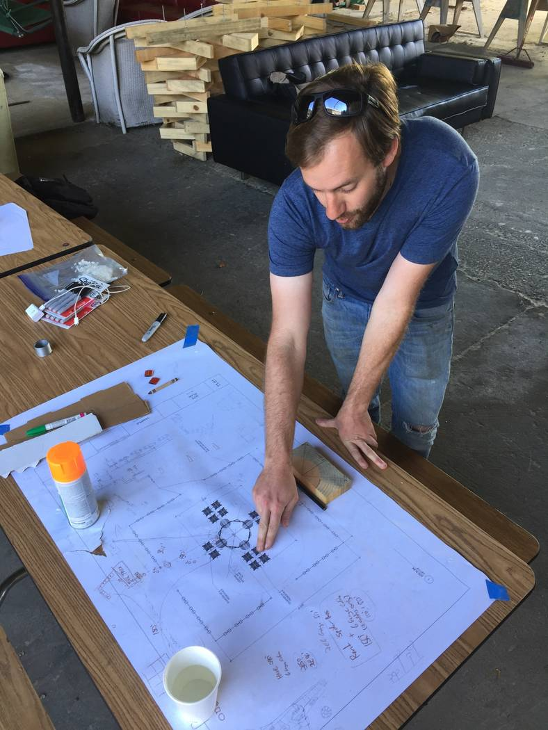 At a warehouse in Oakland, California, Friday, artist and architect Steve Brummond explains the plans for this year's Burning Man temple, which is being built out of trees killed by drought in the ...