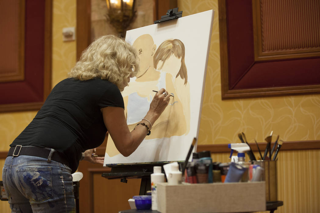 "Artist Meegan Boiros paints a work based on an author's reading during an event, Painted Stories ҅ndless Summer,"" on Sunday, July 16, 2017, at the South Point. Rachel Aston Las Vega ..."
