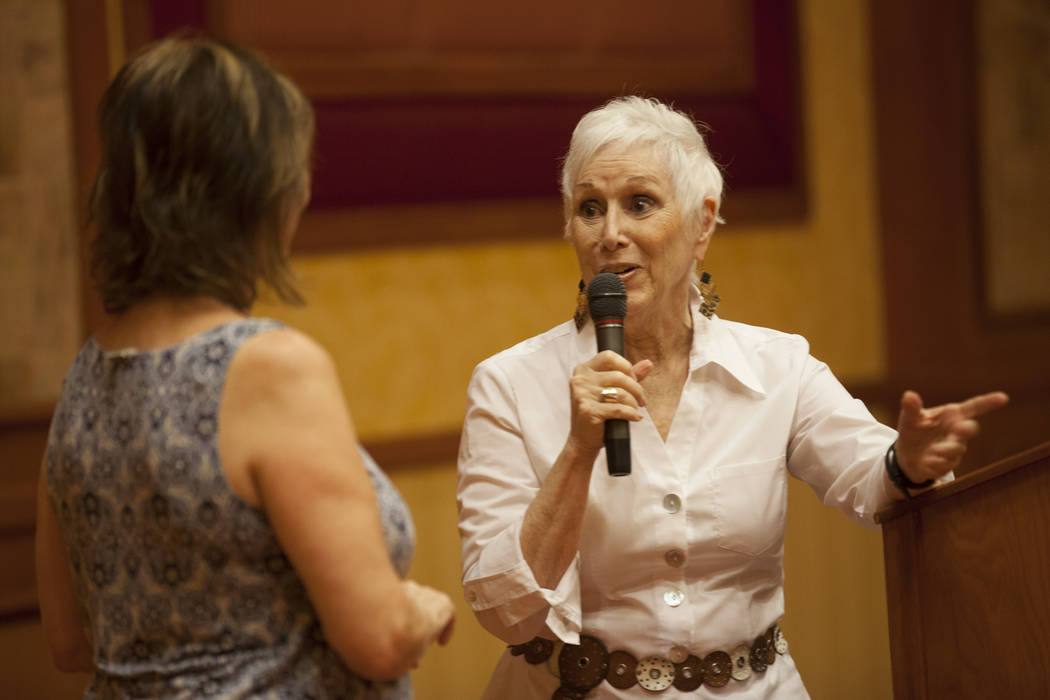 """Morgan St. James, right, asks Linda Lou questions in front of the audience during an event, Painted Stories ҅ndless Summer,"""" on Sunday, July 16, 2017, at the South Point. Rachel Ast ..."""