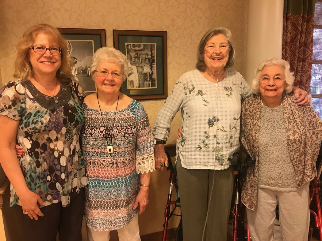 From left, founder of Seniors to the Rescue Gail Mayhugh and Sunrise Senior Living residents Martha Dungan, Frances Watanabe and Gloria Ogiela stand in kitchen at the Sunrise Senior Living facilit ...