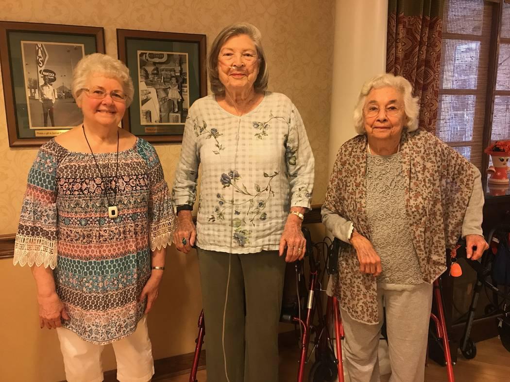 From left, Sunrise Senior Living residents Martha Dungan, Frances Watanabe and Gloria Ogiela stand in kitchen at the Sunrise Senior Living facility, 1555 W. Horizon Ridge Parkway. (Kailyn Brown/ V ...