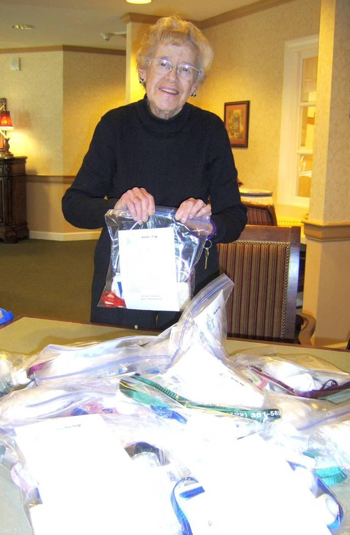 """Gail Mayhugh's mother, Theresa """"Terry"""" Hoffmann, putting together a Boo-Boo Bag for the Seniors to the Rescue. Courtesy of Gail Mayhugh"""