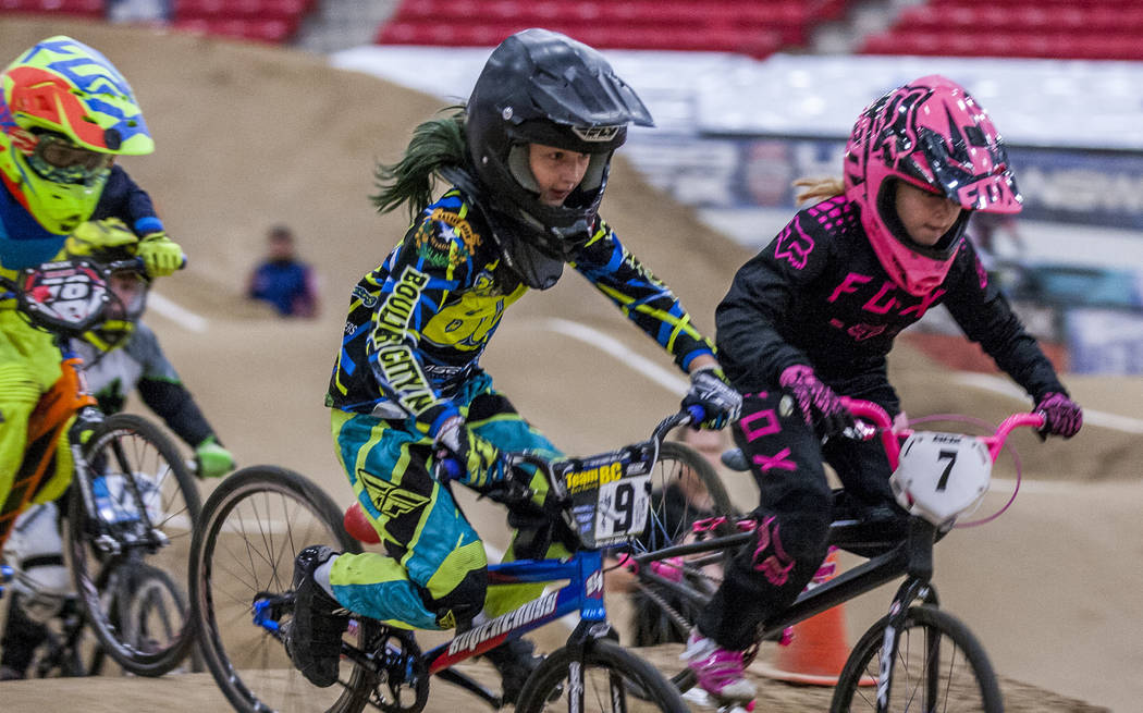 Brooklyn Bowers (9) and Savanna Stokes (7) go head to head during the USA BMX 2017 Las Vegas Nationals at South Point Arena on Sunday, July 16, 2017.  Patrick Connolly Las Vegas Review-Journal @PC ...