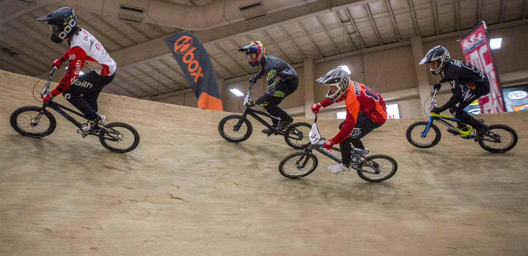 BMX riders make a steep turn during the USA BMX 2017 Las Vegas Nationals at South Point Arena on Sunday, July 16, 2017.  Patrick Connolly Las Vegas Review-Journal @PConnPie