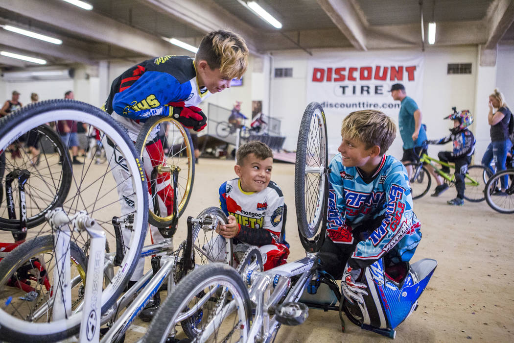 Troy Griffin, 11, from left, Reese Griffin, 7, and Tyler Cowell, 11, of Gilroy, Calif, hang out in between races at the USA BMX 2017 Las Vegas Nationals at South Point Arena on Sunday, July 16, 20 ...