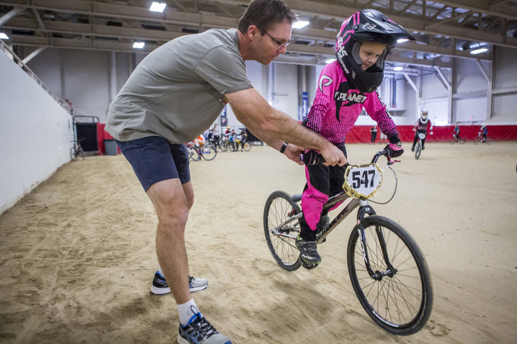 Richard Weatherhead helps his daughter Zoey, 6, warm up at the USA BMX 2017 Las Vegas Nationals at South Point Arena on Sunday, July 16, 2017. The Weatherheads came from Brisbane, Australia to rac ...