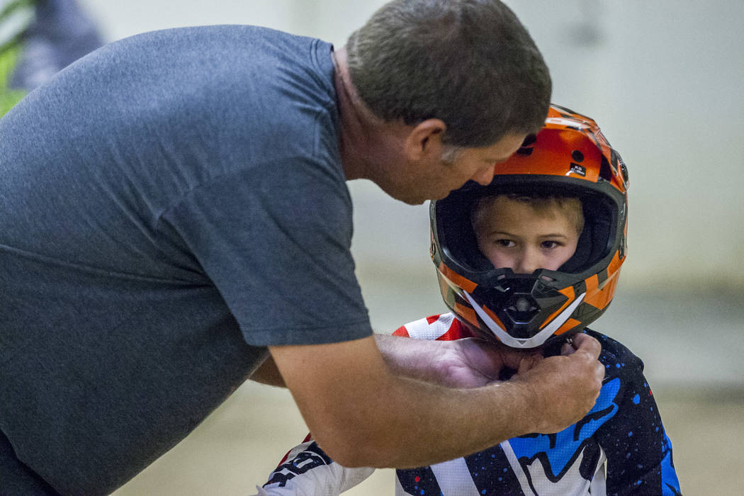 Matt Easley helps his son Tanner, 5, with his helmet at the USA BMX 2017 Las Vegas Nationals at South Point Arena on Sunday, July 16, 2017.  Patrick Connolly Las Vegas Review-Journal @PConnPie
