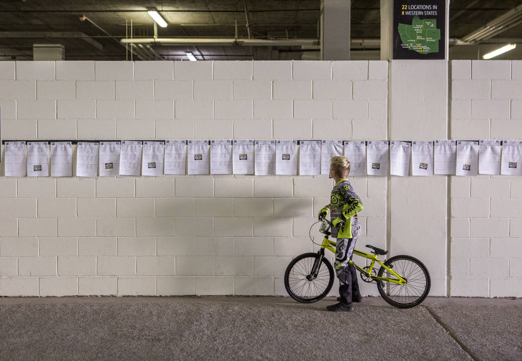 A young BMX rider looks at race times and racer names at the USA BMX 2017 Las Vegas Nationals at South Point Arena on Sunday, July 16, 2017.  Patrick Connolly Las Vegas Review-Journal @PConnPie