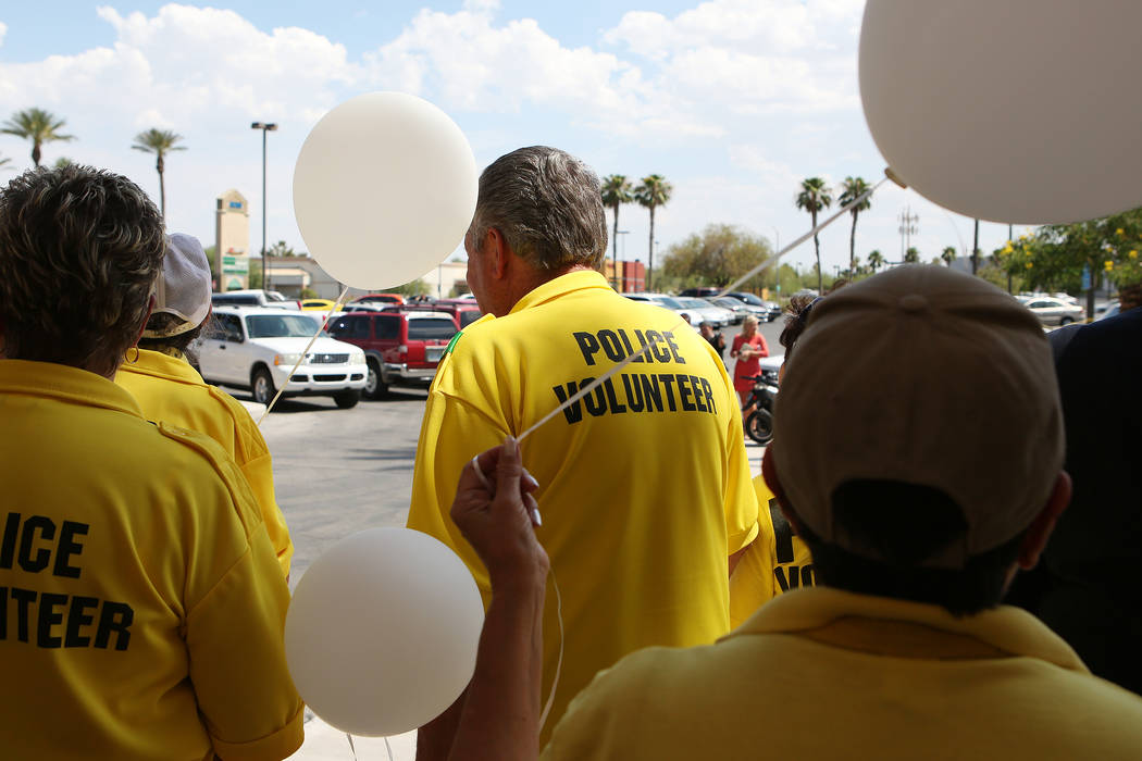 Police volunteers and attendees gather and prepare to release balloons in remembrance of Avery Turner on Thursday, July 13, 2017, in Las Vegas. Turner was found fatally shot on a median at Jones B ...