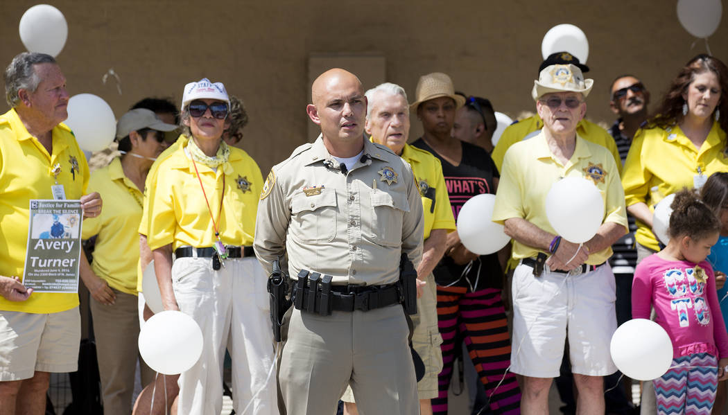 Las Vegas Metropolitan Police Department lieutenant Will Huddler speaks to the media as police volunteers and attendees gather behind him in remembrance of Avery Turner on Thursday, July 13, 2017, ...