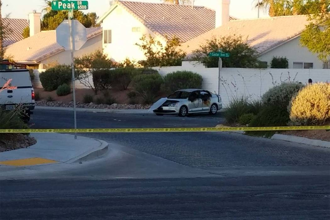 Homicide detectives are investigating after a body was found inside a burning car early Thursday morning, June 22, 2017, at the intersection of Chandler Mews and Castor Tree Way in northwest Las V ...