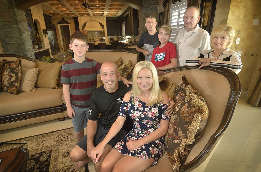 "Brett Raymer, star of ""Tanked"" on Animal Planet, seated front, is shown with his partner Trisha Chamberlain and family members, from left, Bryce Raymer, Chandler and Dylan Chamberlain and Rod  ..."