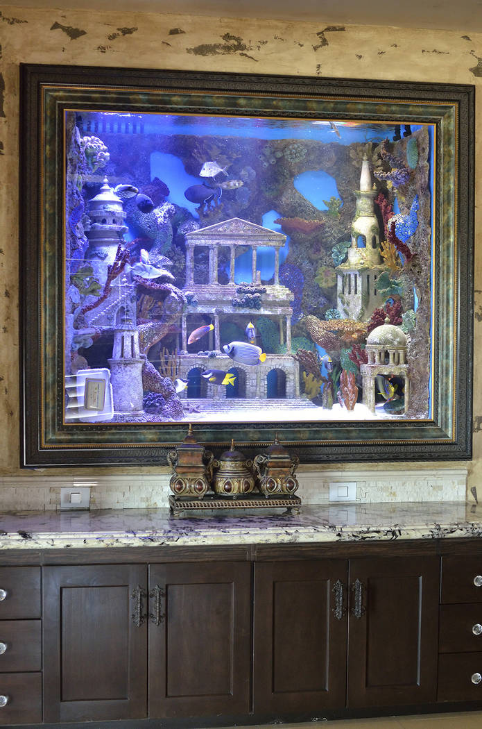 "An aquarium is shown at the home of Brett Raymer, star of ""Tanked"" on Animal Planet. (Bill Hughes/Real Estate Millions)"