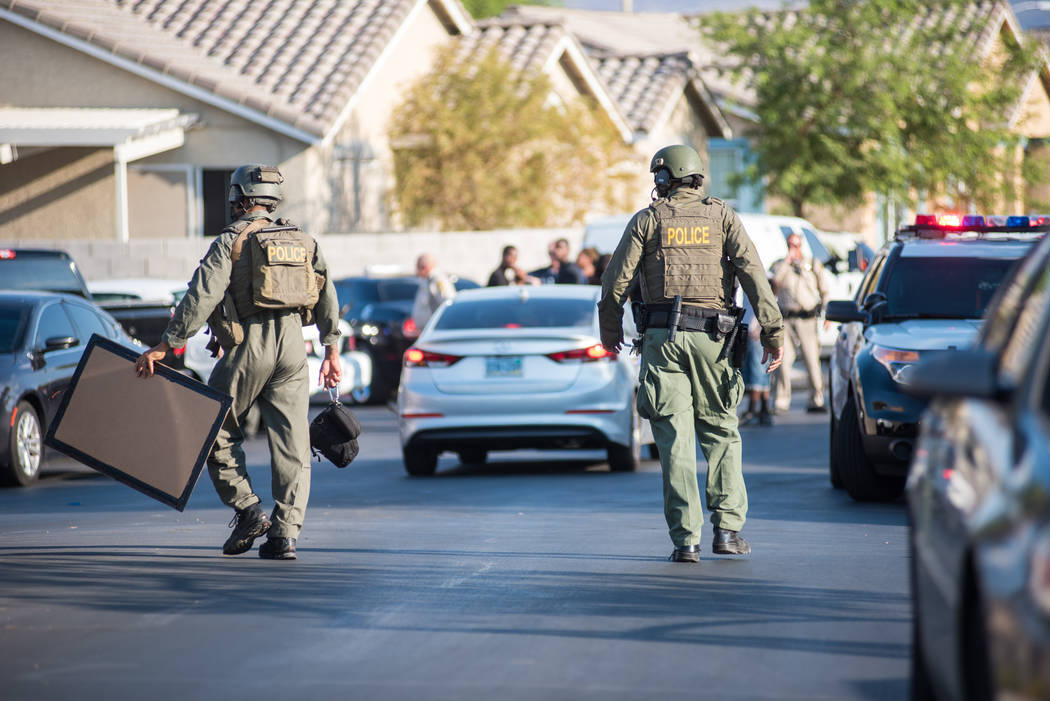 Las Vegas police work to apprehend a person who fired shots at officers in a residential area near Clark County Wetlands Park, Wednesday, July 12, 2017. (Morgan Lieberman Las Vegas Review-Journal)