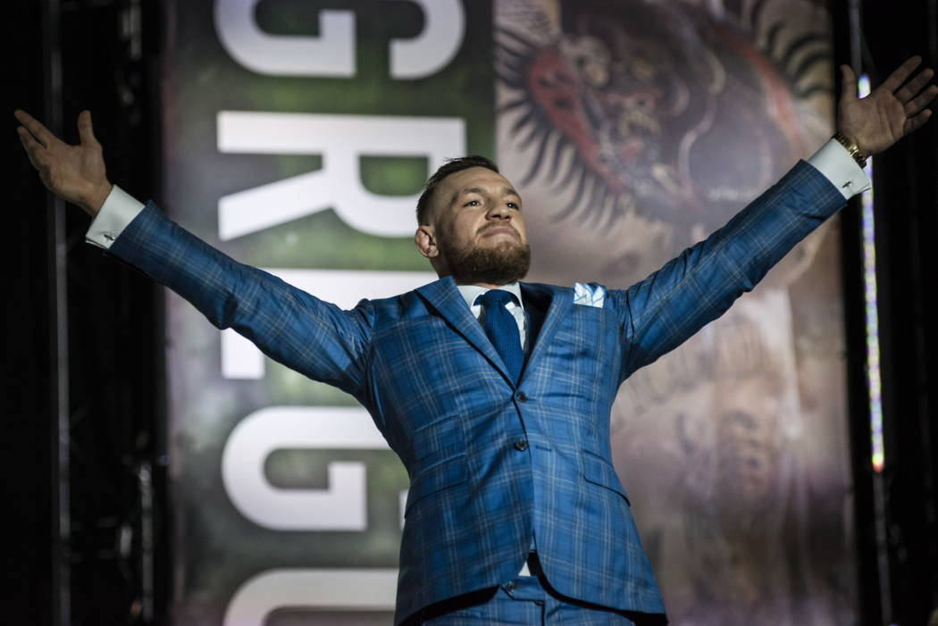 Conor McGregor gestures to the crowd during a promotional stop with Floyd Mayweather in Toronto on Wednesday, July 12, 2017, for their upcoming boxing match in Las Vegas. (Christopher Katsarov/The ...