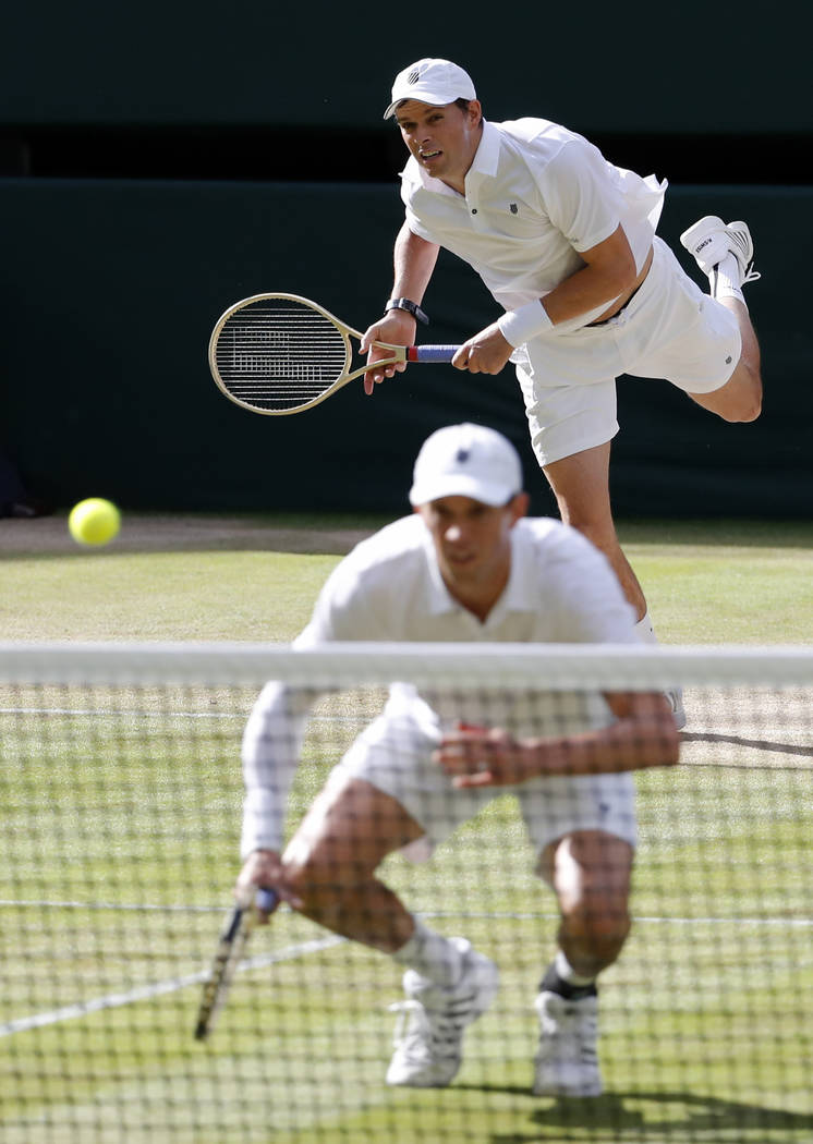 File-This July 5, 2016, file photo shows Mike Bryan, front, and Bob Bryan of the U.S return to Nenad Zimonjic of Serbia and Radek Stepanek of the Czech Republic during their men's doubles match on ...