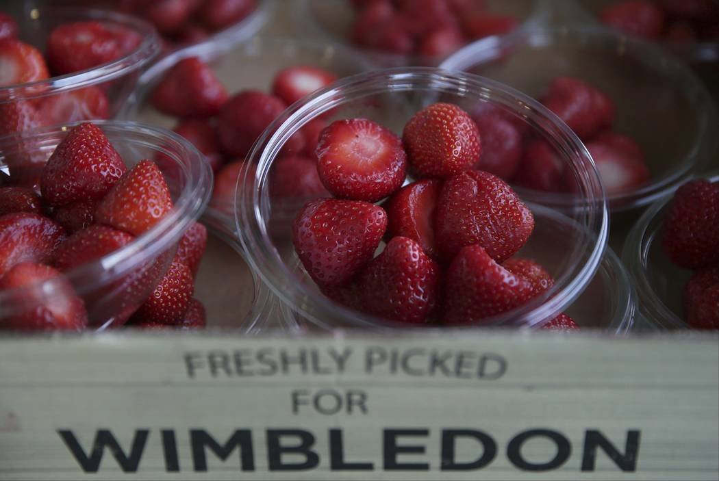 Strawberries for sale on display, on day five at the Wimbledon Tennis Championships in London Friday, July 7, 2017. Green grass, tennis whites and big red strawberries. It can only be Wimbledon -  ...