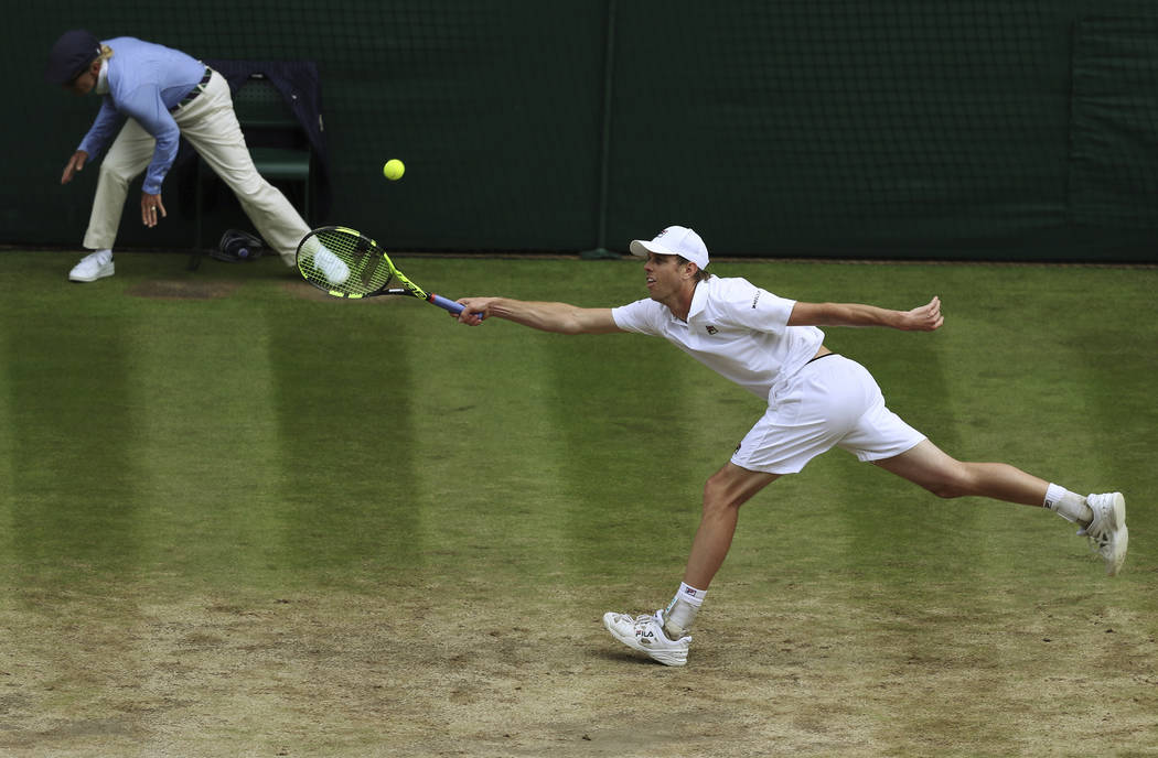Sam Querrey of the United States stretches to return the ball to Croatia's Marin Cilic during their Men's Singles semifinal match on day eleven at the Wimbledon Tennis Championships in London, Fri ...