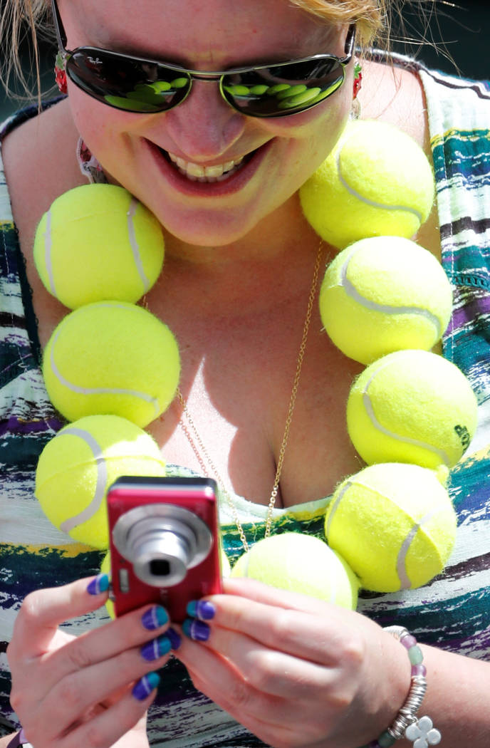 Tennis - Wimbledon - London, Britain - July 12, 2017   A spectator wearing tennis balls on court 1    REUTERS/Matthew Childs - RTX3B4SI
