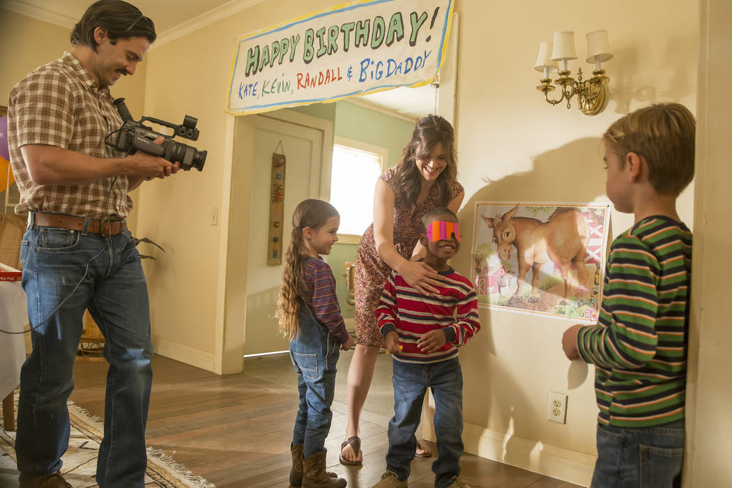 """This image released by NBC shows Milo Ventimiglia and Mandy Moore in """"This is Us."""" The show was nominated for an Emmy Award for outstanding drama series on Thursday, July 13, 2017. (Ron Batzdorff/ ..."""