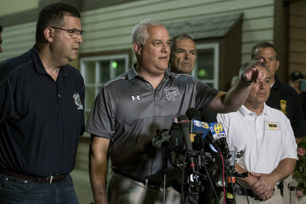 Bucks County District Attorney Matthew Weintraub, center, holds a press conference Thursday, July 13, 2017, in New Hope, Pa., to announce that bodies have been found on a Solebury Township farm be ...