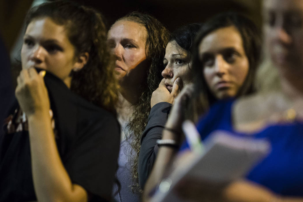Young women listen to Matthew Weintraub, District Attorney for Bucks County, Pa., speak during a news conference in New Hope, Pa., Thursday, July 13, 2017. Authorities said they've found human rem ...