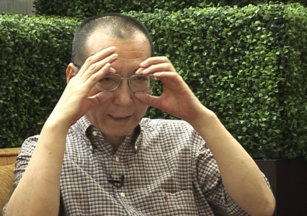 In this image taken from June 3, 2008, video footage, Liu Xiaobo speaks during an interview before his detention in Beijing, China. (AP Video via AP)