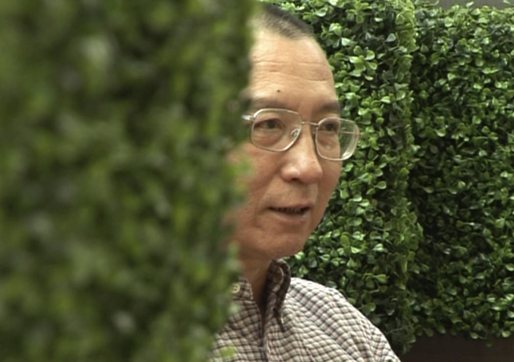 In this image taken from June 3, 2008, video footage by AP Video, Liu Xiaobo speaks during an interview before his detention in Beijing, China. (AP Video via AP)