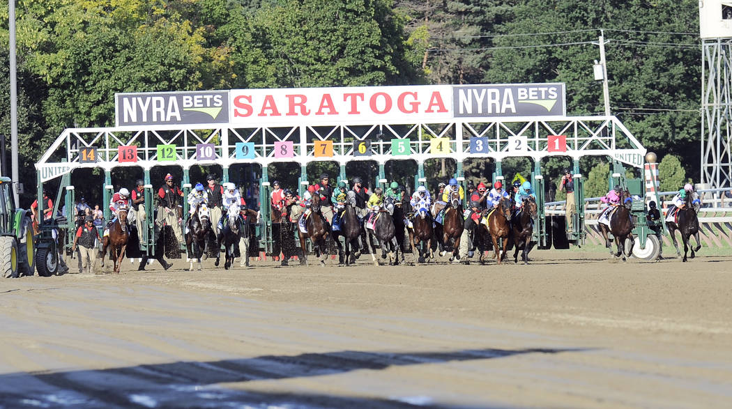Arrogate with Mike Smith aboard ,right, set a track record winning The Travers Stakes horse race at Saratoga Race Course in Saratoga Springs, N.Y., Saturday, Aug. 27, 2016. (AP Photo/Hans Pennink)