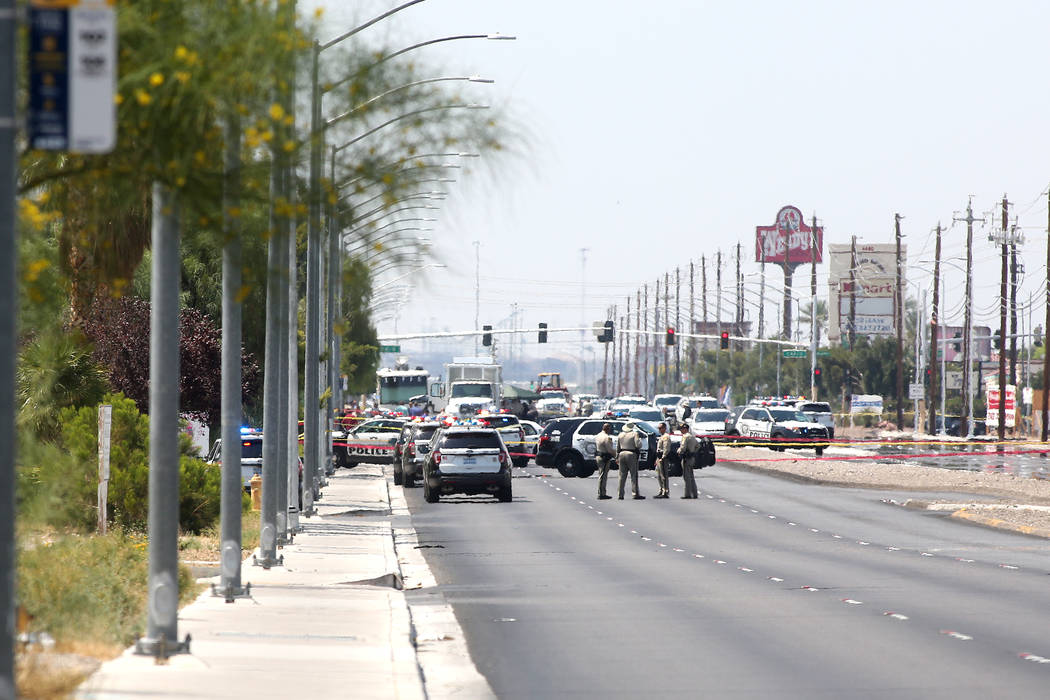 A heavy presence of officers on North Rancho Drive between North Jones Boulevard and West Craig Road where an officer involved shooting occurred on Tuesday, July 11, 2017, in Las Vegas. (Bridget B ...